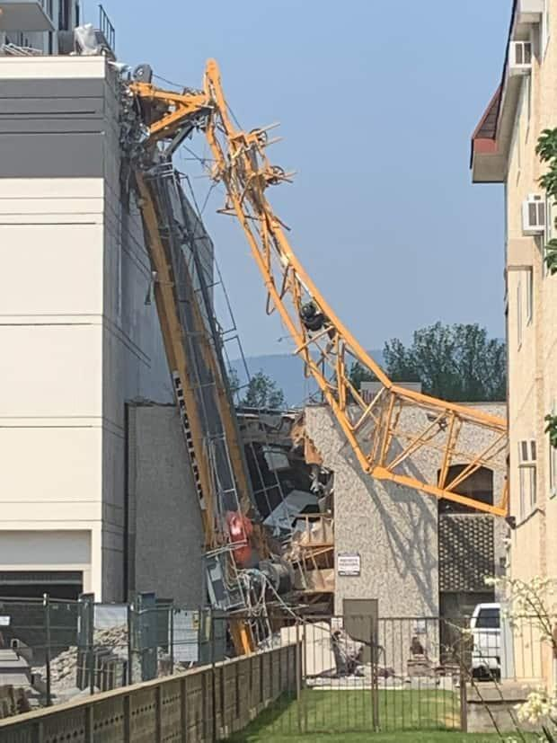 The area surrounding a construction site in Kelowna, B.C., where a crane collapsed on Monday morning.  (CBC - image credit)