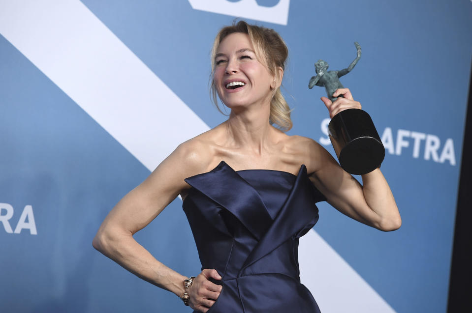 "FILE - Renee Zellweger poses in the press room with the award for outstanding performance by a female actor in a leading role for ""Judy"" at the 26th annual Screen Actors Guild Awards on Jan. 19, 2020, in Los Angeles. Zellweger has earned her first Grammy nomination this year. The ""Judy"" soundtrack, which features Zellweger covering songs like ""Over the Rainbow"" and ""The Trolley Song,"" is nominated for best traditional pop vocal album. (Photo by Jordan Strauss/Invision/AP, File)"