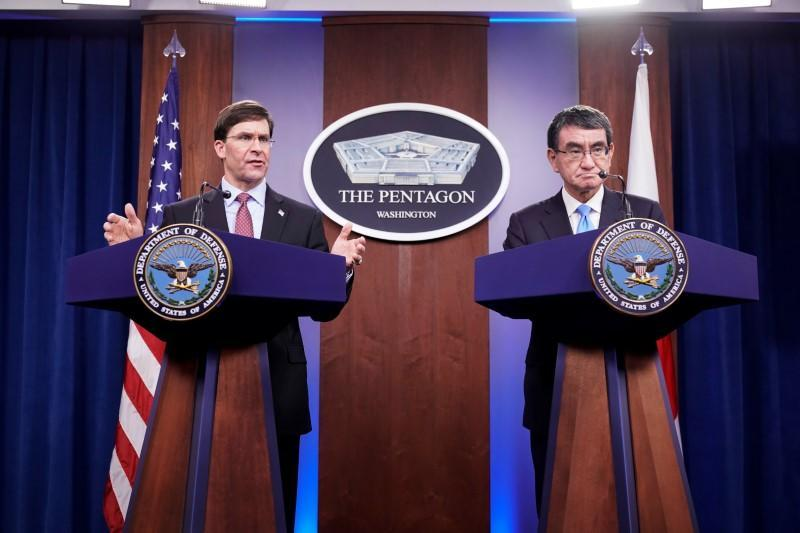 U.S. Secretary of Defense Mark Esper speaks as Japan's Defense Minister Taro Kono looks on during a joint news conference at the Pentagon in Washington