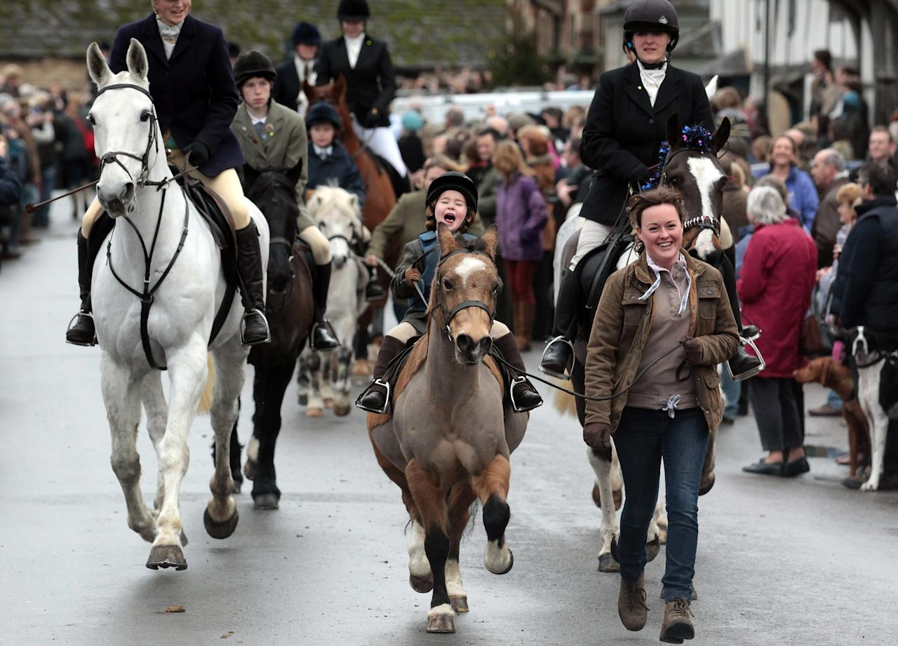 """LACOCK, UNITED KINGDOM - DECEMBER 26:  A young rider joins the Avon Vale Hunt, as they ride out for their traditional Boxing Day hunt, on December 26, 2011 in Lacock, England. As hundreds of hunts gather today for their traditional Boxing Day meets. Agriculture Minister Jim Paice has said the Hunting Act """"simply doesn't work"""" and added that there should be a vote on whether to repeal the act when there was """"time in the parliamentary calendar"""".  (Photo by Matt Cardy/Getty Images)"""