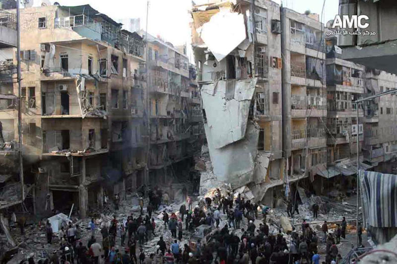 In this Tuesday, Dec. 17, 2013 citizen journalism image provided by Aleppo Media Center, AMC, and released Wednesday, Dec. 18, 2013, which has been authenticated based on its contents and other AP reporting, Syrians inspect the rubble of damaged buildings following a Syrian government airstrike in Aleppo, Syria. A burst of strength by al-Qaida that is chipping away at the remains of Mideast stability now confronts President Barack Obama, testing his hands-off approach to conflicts in Iraq and Syria at the same time he pushes to keep thousands of U.S. forces in Afghanistan. (AP Photo/Aleppo Media Center, AMC)