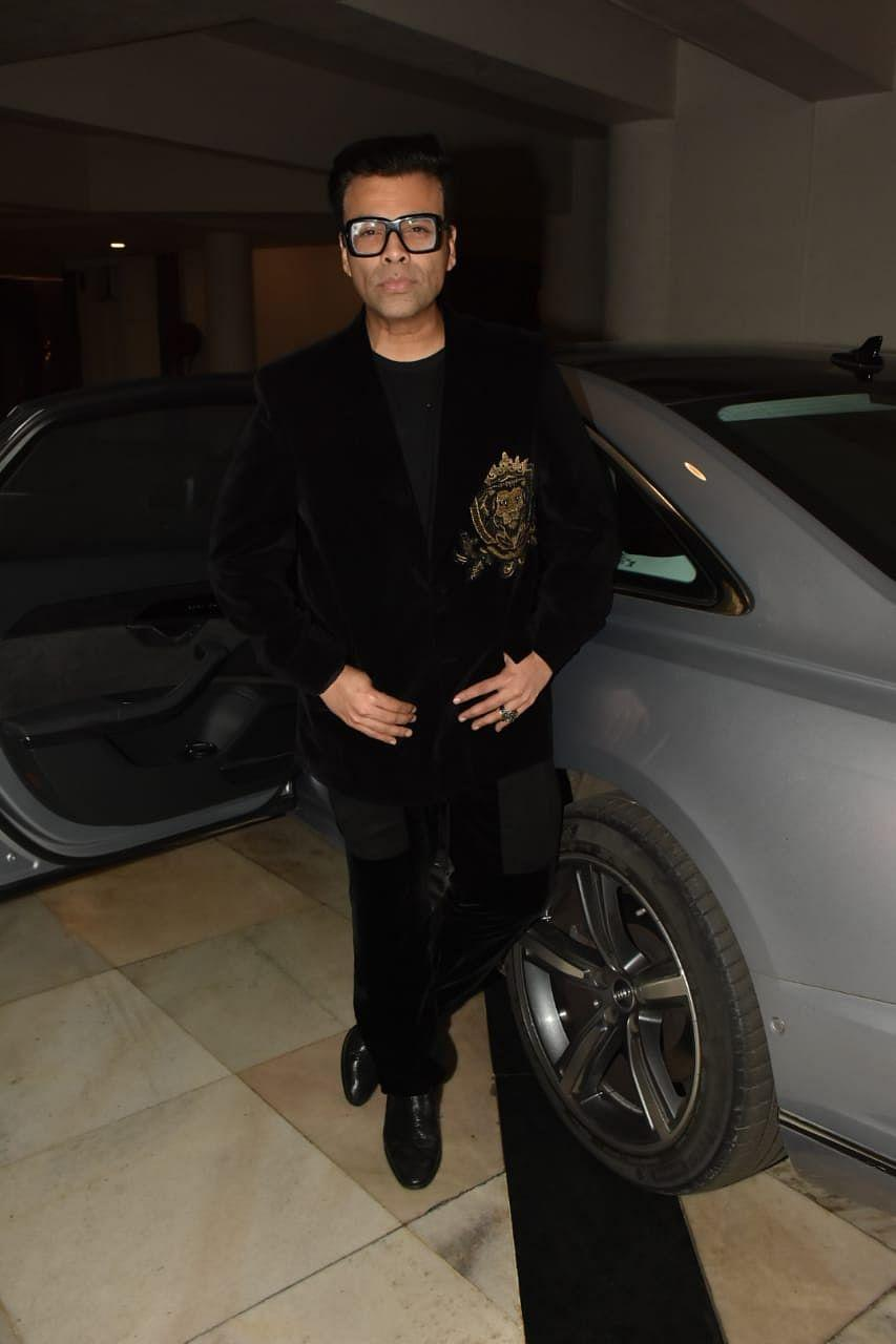 """<div class=""""paragraphs""""><p>Karan Johar was a part of the get-together at Manish Malhotra's place.</p></div>"""