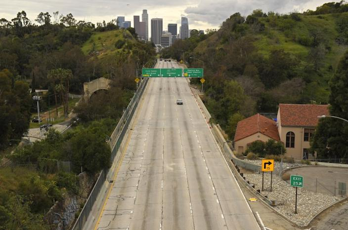 "The 110 Freeway heading into downtown Los Angeles is nearly empty on March 20, the day after California Gov. Newsom issued a statewide coronavirus stay-at-home order. <span class=""copyright"">(Mark J. Terrill / Associated Press )</span>"