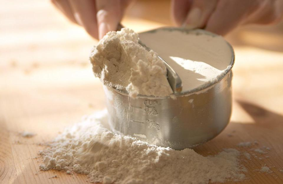 """<p>One thing to keep in mind when baking is that measuring dry ingredients is different from measuring liquids. When <a href=""""https://www.thedailymeal.com/eat/improve-pancakes-ingredients?referrer=yahoo&category=beauty_food&include_utm=1&utm_medium=referral&utm_source=yahoo&utm_campaign=feed"""" rel=""""nofollow noopener"""" target=""""_blank"""" data-ylk=""""slk:baking something like pancakes"""" class=""""link rapid-noclick-resp"""">baking something like pancakes</a>, which require a lot of dry ingredients, scoop the mix into your measuring cup and tap across the surface with a knife to level it off.</p>"""
