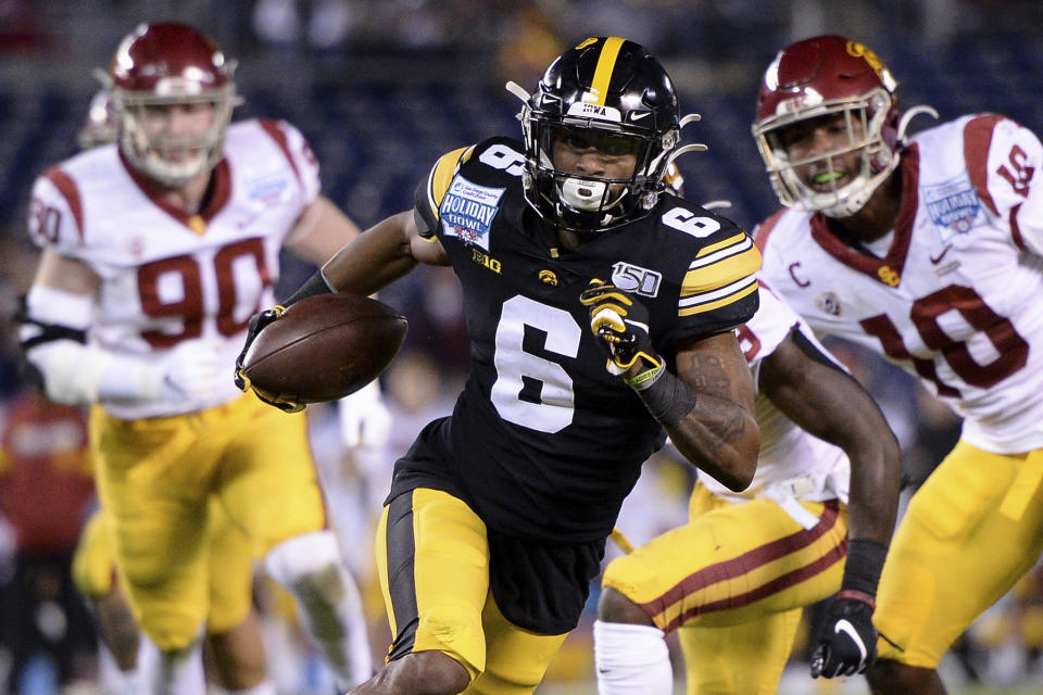 FILE - In this Dec. 27, 2019, file photo, Iowa wide receiver Ihmir Smith-Marsette (6) runs with the ball for a touchdown during the first half of the Holiday Bowl NCAA college football game against Southern California in San Diego. One of the biggest problems for the Minnesota Vikings last season was the performance of their special teams units. They made improvement there a clear priority on the third day of the draft by selecting Iowa State running back Kene Nwangwu in the fourth round, and Iowa wide receiver Ihmir Smith-Marsette in the fifth round. (AP Photo/Orlando Ramirez, File)