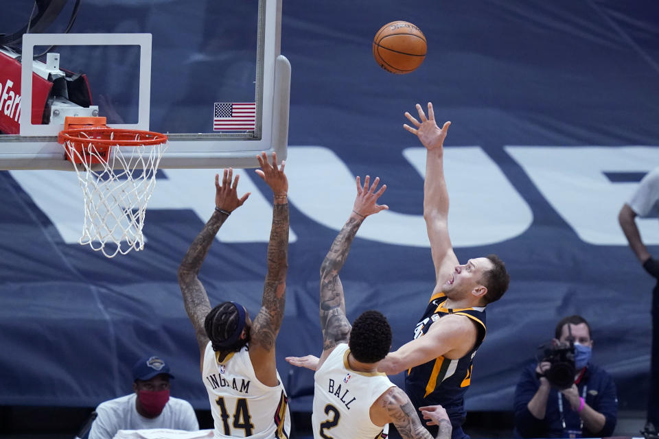 Utah Jazz forward Bojan Bogdanovic, front right, shoots over New Orleans Pelicans forward Brandon Ingram (14) and guard Lonzo Ball (2) in the first half of an NBA basketball game in New Orleans, Monday, March 1, 2021. (AP Photo/Gerald Herbert)