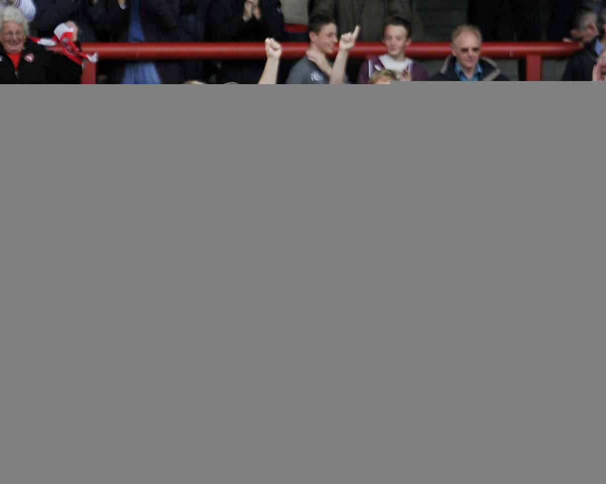 Morecambe's Jack Simpson (Second Left) celebrates after he scores the third goal of the game for his side during the Sky Bet League Two match at Globe Arena, Morecambe.