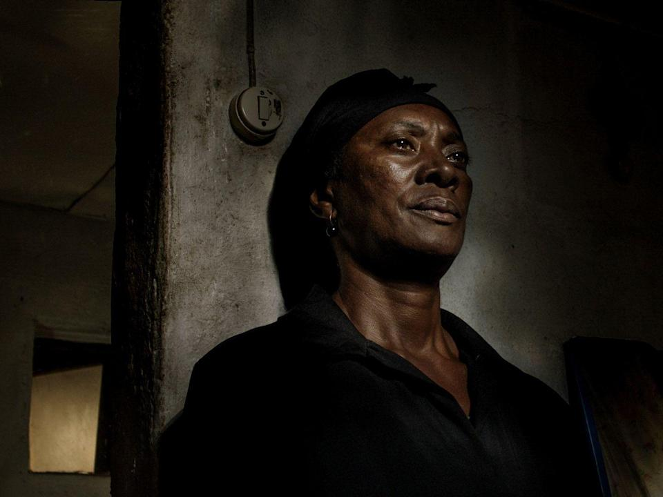 <p>The darkness is all-consuming, as is despair over a lost past and future, and a purgatorial present, in <em>Vitalina Varela</em>, Pedro Costa's aesthetically ravishing true tale of its protagonist, a Cape Verde resident who returns to Portugal mere days after her estranged husband's death. Vitalina wanders through this dilapidated and gloomy environment, which Costa shoots almost exclusively at night, the better to conjure a sense of ghosts navigating a dreamscape of sorrow, suffering and disconnection. Each of the director's images is more ravishing than the next, and their beauty – along with an enveloping soundscape of squeaking beds, sheets blowing in the wind, and rain pattering on crumbling roofs – is enchanting. Presenting its story through fractured plotting and dreamy monologues, the Portuguese master's latest is a series of tableaus of lovelorn grief concerning not only Vitalina but also an aged priest in spiritual crisis and another young man poised to endure his own tragedy. The film's formal grandeur – its compositional precision, and painterly interplay of light and dark – is overwhelming, as is the majestic presence of Vitalina herself.</p>