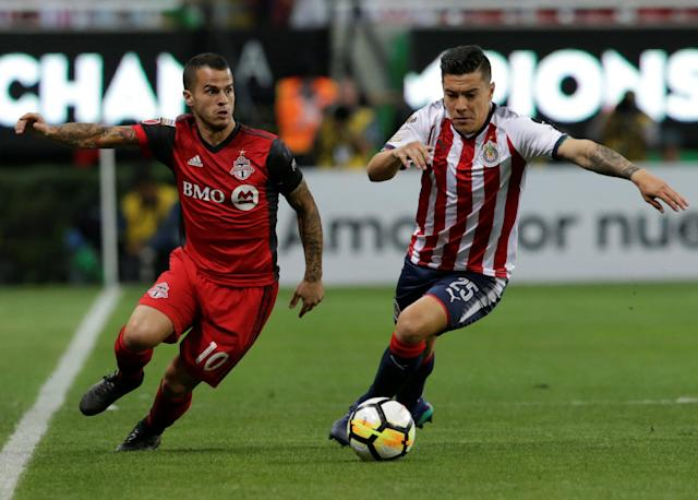 Soccer Football - CONCACAF Champions League final - Guadalajara v Toronto FC - Akron stadium, Zapopan, Mexico - April 25, 2018 - Sebastian Giovinco of Toronto FC and Michael Perez of Guadalajara in action. REUTERS/Henry Romero