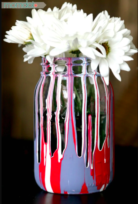 """<p>A little milk paint and a mason jar can help you make some stunning red, white, and blue drip paint jars. </p><p><strong><em>Get the tutorial from <a href=""""https://www.momdot.com/drip-painting-mason-jars-diy/"""" rel=""""nofollow noopener"""" target=""""_blank"""" data-ylk=""""slk:MomDot"""" class=""""link rapid-noclick-resp"""">MomDot</a>. </em></strong></p>"""