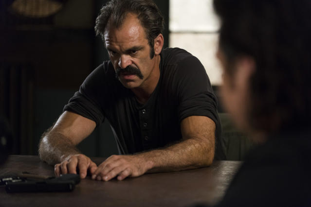 <p>Steven Ogg as Simon and Josh McDermitt as Dr. Eugene Porter in AMC's <i>The Walking Dead.><br> (Photo: Gene Page/AMC)</i> </p>