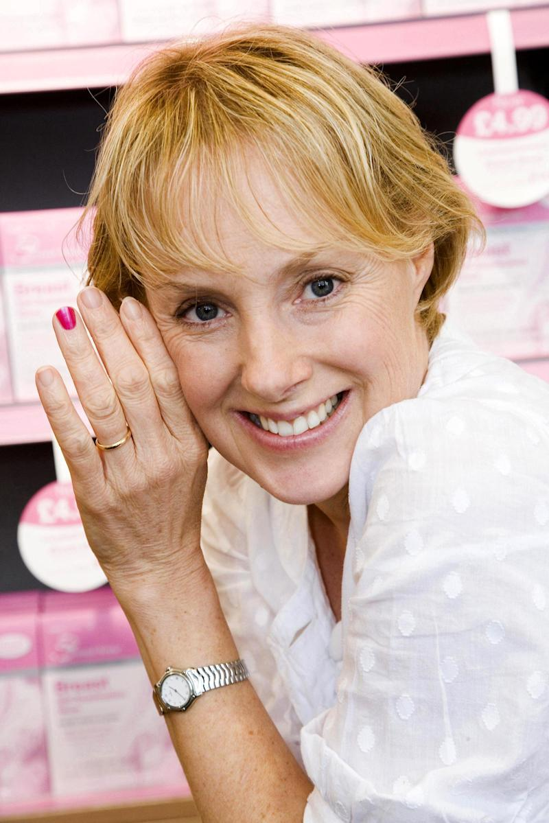 Standalone Photo. Coronation Street actress Sally Whittaker wears pink nail polish on one fingernail to show her support for the Lloydspharmacy/Genesis Appeal 'Paint it Pink' campaign, at a branch of Lloydspharmacy in Manchester, on Monday September 24. (Photo by Bob Collier - PA Images/PA Images via Getty Images)