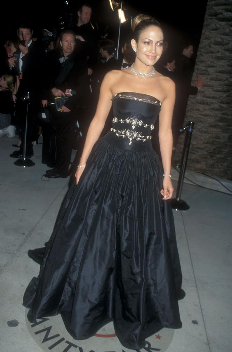 For the 1999 Oscars, Lopez opted for a more classic look, another Badgely Mischka design (the same label she had worn for the event two years prior). Jennifer Lopez in Badgely Mischka at the Vanity Fair Oscar Party in Los Angeles, California, March 1999. Photo by Barry King/WireImage.
