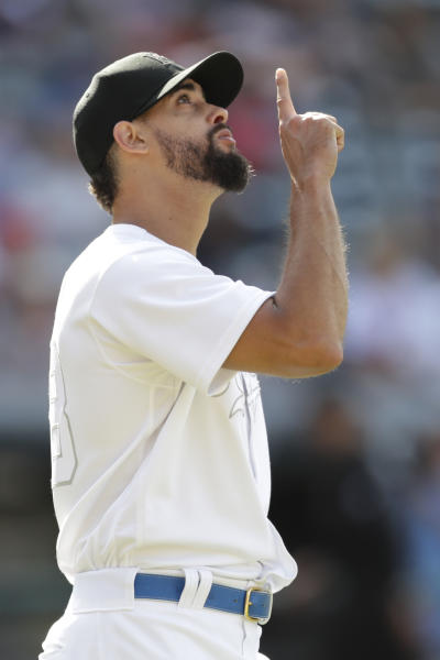 Kansas City Royals relief pitcher Jorge Lopez points up after the Royals defeated the Cleveland Indians in a baseball game, Sunday, Aug. 25, 2019, in Cleveland. (AP Photo/Tony Dejak)