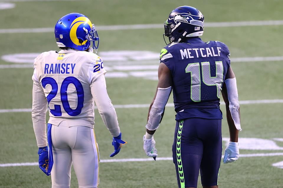 SEATTLE, WASHINGTON - DECEMBER 27: Jalen Ramsey #20 of the Los Angeles Rams and DK Metcalf #14 of the Seattle Seahawks have a conversation in the fourth quarter at Lumen Field on December 27, 2020 in Seattle, Washington. (Photo by Abbie Parr/Getty Images)