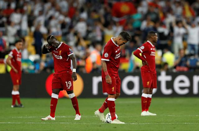 Soccer Football - Champions League Final - Real Madrid v Liverpool - NSC Olympic Stadium, Kiev, Ukraine - May 26, 2018 Liverpool's Sadio Mane and Roberto Firmino look dejected after Real Madrid's Gareth Bale scores their third goal REUTERS/Andrew Boyers