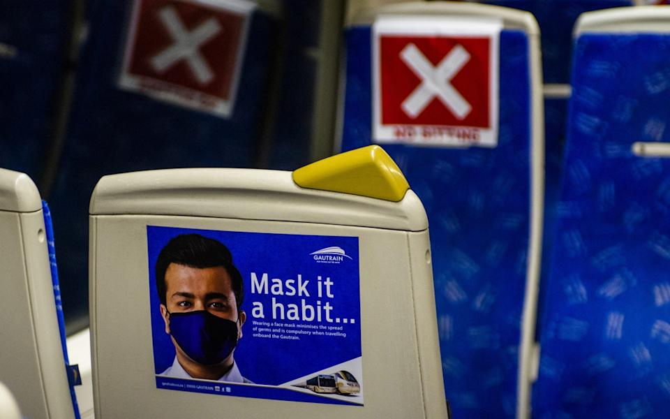 A sign advising of mandatory mask wearing by passengers on-board a Gautrain passenger train in Pretoria, South Africa, on September 10 - Waldo Swiegers / Bloomberg