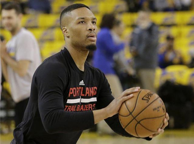 "<a class=""link rapid-noclick-resp"" href=""/nba/players/5012/"" data-ylk=""slk:Damian Lillard"">Damian Lillard</a> averaged 27 points per game this past season. (AP)"
