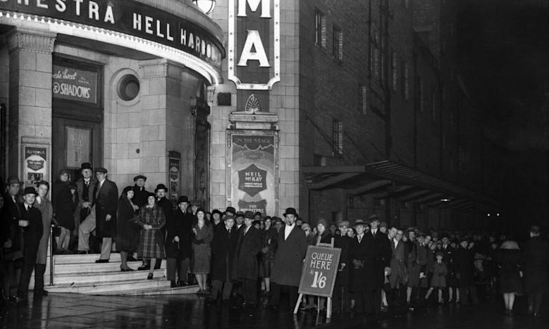 A long queue outside London's Brixton Astoria music hall in 1930.