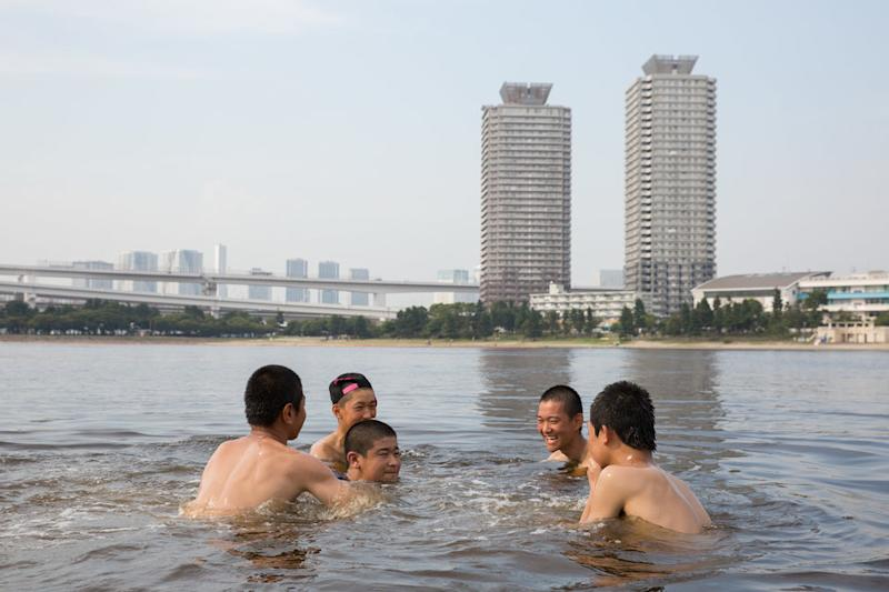 People cool off in a Tokyo park on 22 July.