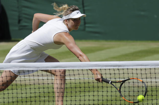 Ukraine's Elina Svitolina returns to Romania's Simona Halep in a Women's semifinal singles match on day ten of the Wimbledon Tennis Championships in London, Thursday, July 11, 2019. (AP Photo/Ben Curtis)