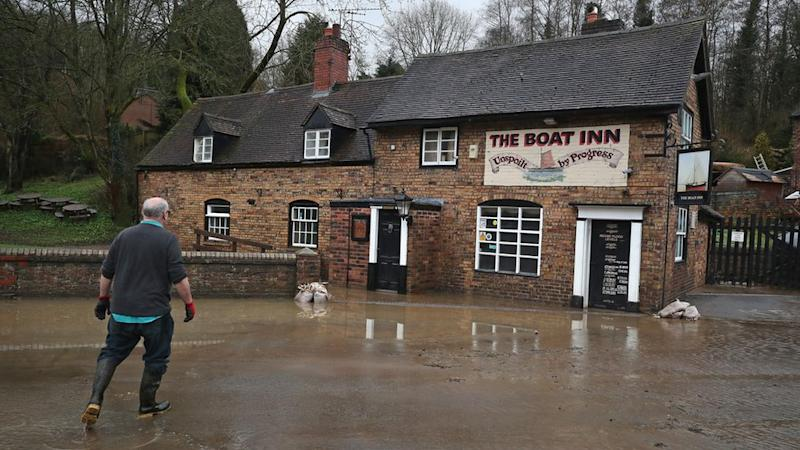 A resident at the Boat Inn in Jackfield near Ironbridge after flood water has started to recede