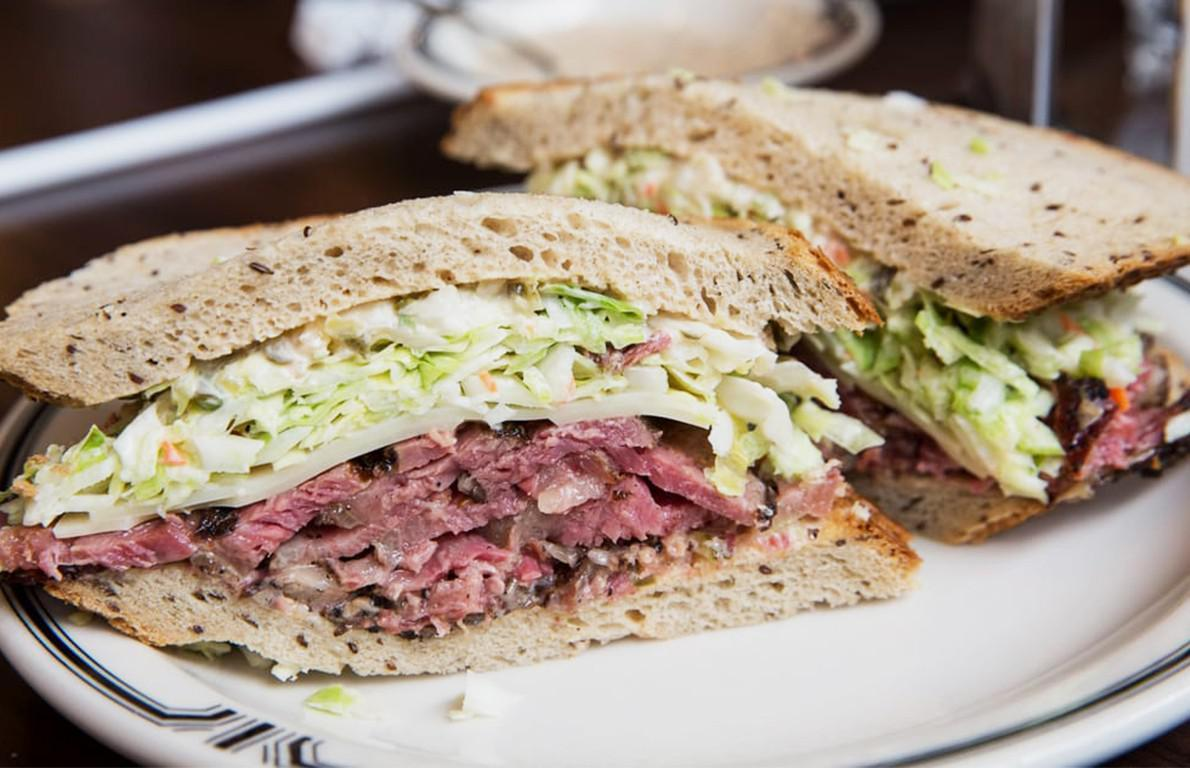 """<p>Since opening back in 1947,<a href=""""http://www.thedailymeal.com/langers-delicatessen-restaurant?referrer=yahoo&category=beauty_food&include_utm=1&utm_medium=referral&utm_source=yahoo&utm_campaign=feed"""">Langer's Delicatessen</a>in Los Angeles, <a href=""""https://www.thedailymeal.com/best-food-drink-california-gallery?referrer=yahoo&category=beauty_food&include_utm=1&utm_medium=referral&utm_source=yahoo&utm_campaign=feed"""">California</a>, has grown to become one of the premier Jewish delis on the West Coast. Many of their fans refer to Langer's as the best deli west of the Hudson River, and few who've tried their sandwiches would disagree. The deli's crowning achievement, and one of the great Los Angeles sandwiches, is the #19. Essentially a Reuben with pastrami instead of corned beef, it starts with hand-cut, house-made pastrami and is topped with coleslaw, Russian dressing and Swiss cheese, served between two slices of double-baked rye bread. It's simple, but it's a masterpiece.</p>"""
