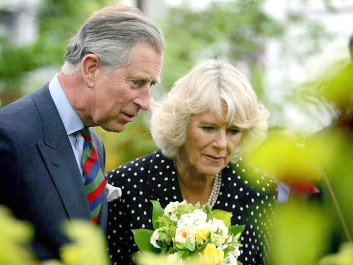 Prince Charles and Camilla in a garden