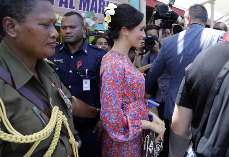 Meghan, Duchess of Sussex during a visit to a market in Suva, Fiji, Wednesday, Oct. 24, 2018. Britain's Prince Harry and his wife Meghan are on day nine of their 16-day tour of Australia and the South Pacific.(AP Photo/Kirsty Wigglesworth, Pool)