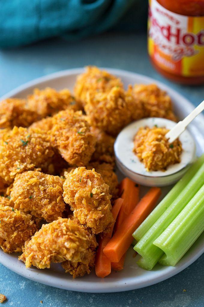 "<p>These baked bites get a crispy coating from crushed corn flakes. </p><p><strong>Get the recipe at <a href=""https://lifemadesimplebakes.com/2018/07/crispy-buffalo-chicken-nuggets/"" rel=""nofollow noopener"" target=""_blank"" data-ylk=""slk:Life Made Simple"" class=""link rapid-noclick-resp"">Life Made Simple</a>.</strong></p>"