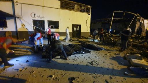Emergency workers recover bodies after an air strike on a migrant detention centre in Libya