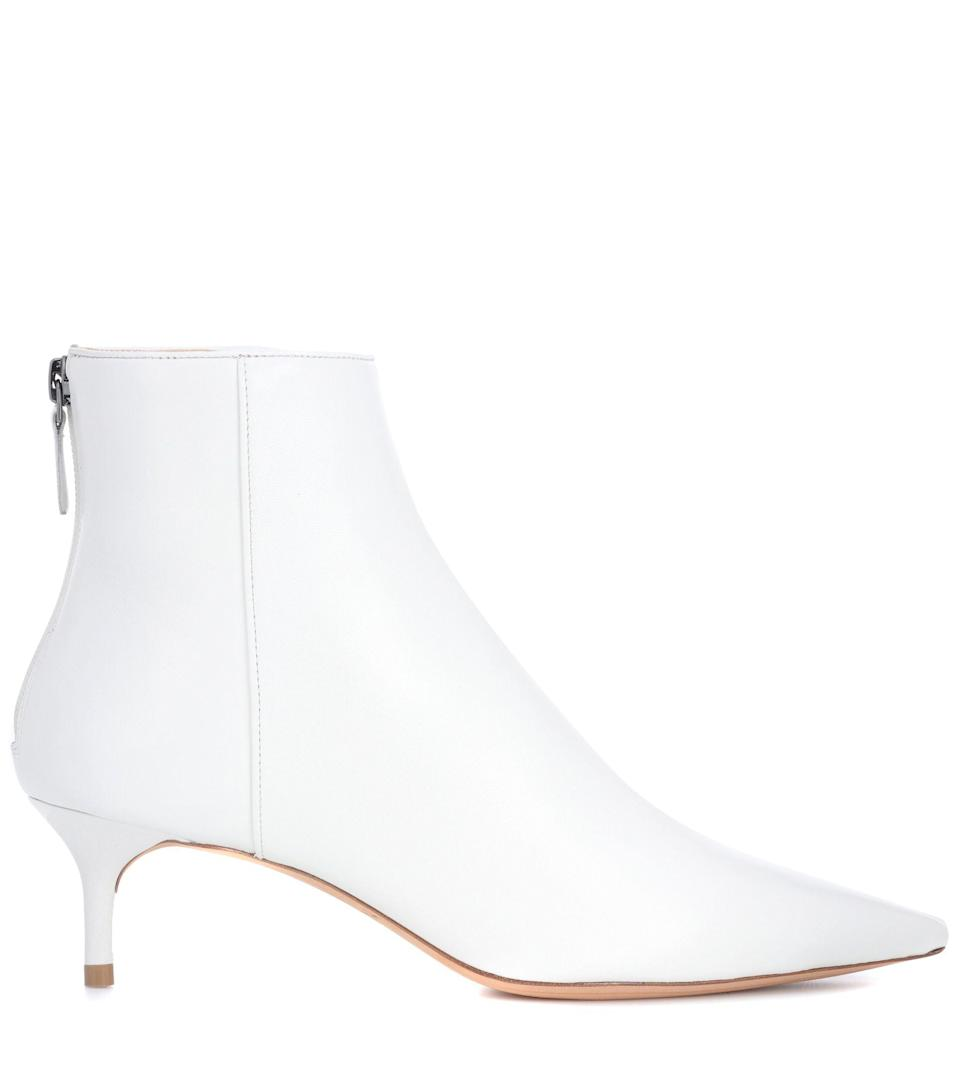 """<p><strong>Alexandre Birman</strong></p><p>mytheresa.com</p><p><strong>$356.00</strong></p><p><a href=""""https://go.redirectingat.com?id=74968X1596630&url=https%3A%2F%2Fwww.mytheresa.com%2Fen-us%2Falexandre-birman-kittie-leather-ankle-boots-1039278.html&sref=https%3A%2F%2Fwww.harpersbazaar.com%2Ffashion%2Ftrends%2Fg7958%2Fhow-to-wear-ankle-boots%2F"""" rel=""""nofollow noopener"""" target=""""_blank"""" data-ylk=""""slk:Shop Now"""" class=""""link rapid-noclick-resp"""">Shop Now</a></p><p>Score Alexandre Birman's bootie while it's still in on sale and then proceed to wear it with all your fall looks—from midi dresses to skinny jeans.</p>"""