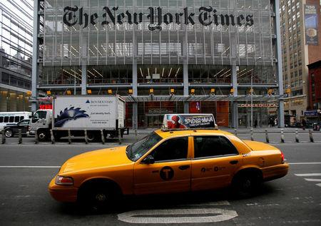 FILE PHOTO: A taxi passes by in front of The New York Times head office in New York