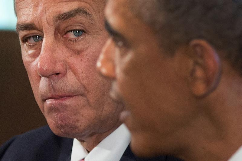 FILE - In this Sept. 3, 2013, file photo House Speaker John Boehner of Ohio listens as President Barack Obama speaks to media in the Cabinet Room of the White House in Washington. As lawmakers end their five-week recess, they will plunge into an emotional debate over whether to bomb Syria. No member of Congress is in a tighter spot than Boehner, who risks seeing most of his Republican colleagues vote against him on three major issues, Syria, the debt limit, and immigration reform. (AP Photo/Carolyn Kaster, File)