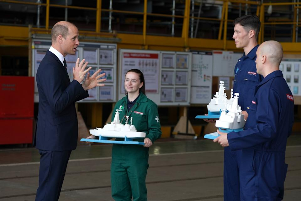 GLASGOW, SCOTLAND - JUNE 29: Prince William, the Earl of Strathearn receives models of Royal Navy warships as gifts from staff during a visit to the BAE Systems shipyard to observe construction of HMS Glasgow, the Royal Navy's first City-class Type 26 frigate on June 29, 2021 in Glasgow, Scotland. (Photo by Andrew Milligan - WPA Pool/Getty Images)
