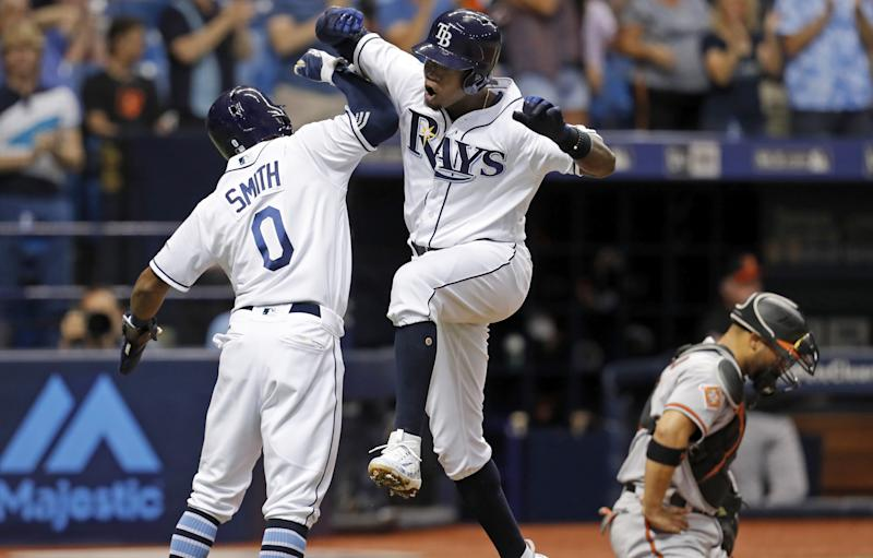 Tampa Bay Rays' Tim Beckham, center, celebrates his three-run home run with Mallex Smith as Baltimore Orioles catcher Welington Castillo reacts during the second inning of a baseball game Tuesday, July 25, 2017, in St. Petersburg, Fla.