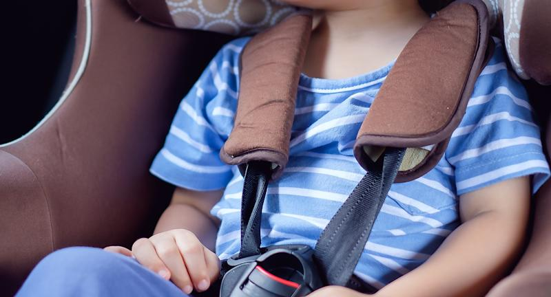 A toddle pictured in a car seat.