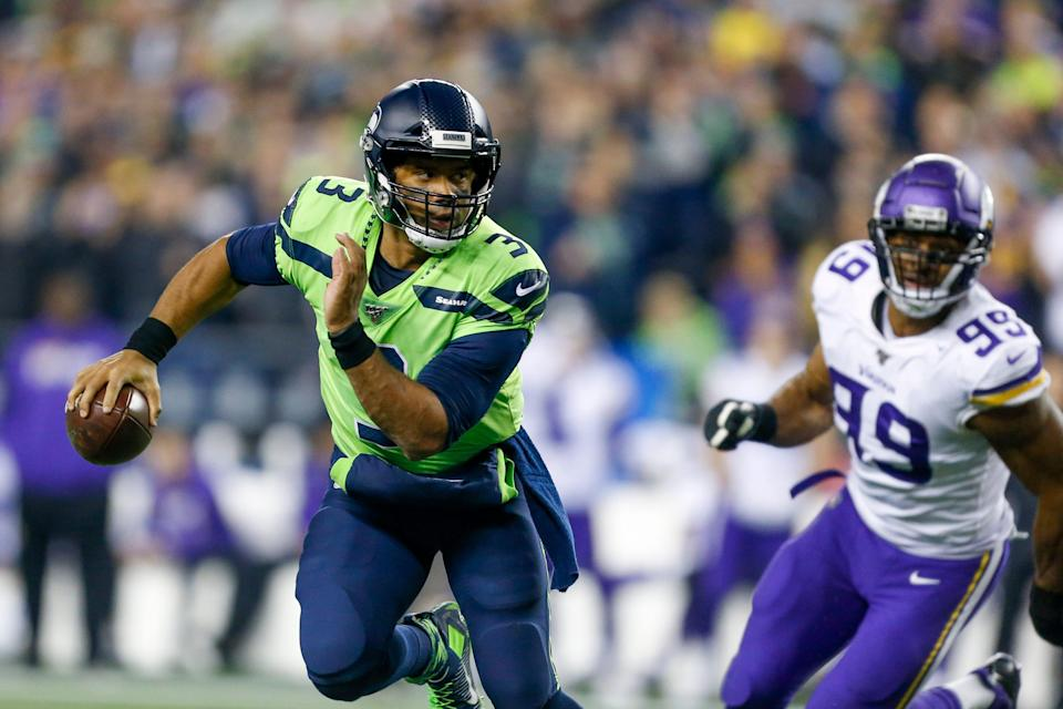 Russell Wilson scrambles out of the pocket during a 27-26 win against the Minnesota Vikings on Oct. 11, 2020.