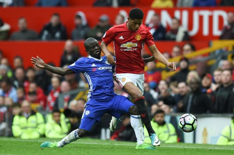 Chelsea's N'Golo Kante (L) tackles Manchester United's Marcus Rashford during their English Premier League football match, at Old Trafford in Manchester, on April 16, 2017