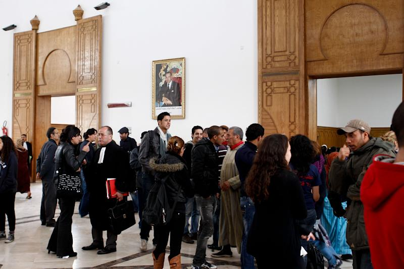 """Activists and lawyers wait in the court building during the case of Mouad Belghouat, the Moroccan rapper, also known as El-Haqed, or """"the enraged"""", in Casablanca Wednesday April 4, 2012. A Moroccan court denied bail on Wednesday to a rapper charged with attacking the image of the security services in a song about police corruption. (AP Photo/Abdeljalil Bounhar)"""