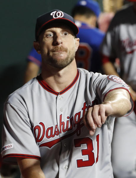 Washington Nationals starting pitcher Max Scherzer rests in the dugout after pitching six innings of the team's baseball game against the New York Mets in which he allowed six hits but no runs, Wednesday, May 22, 2019, in New York. (AP Photo/Kathy Willens)