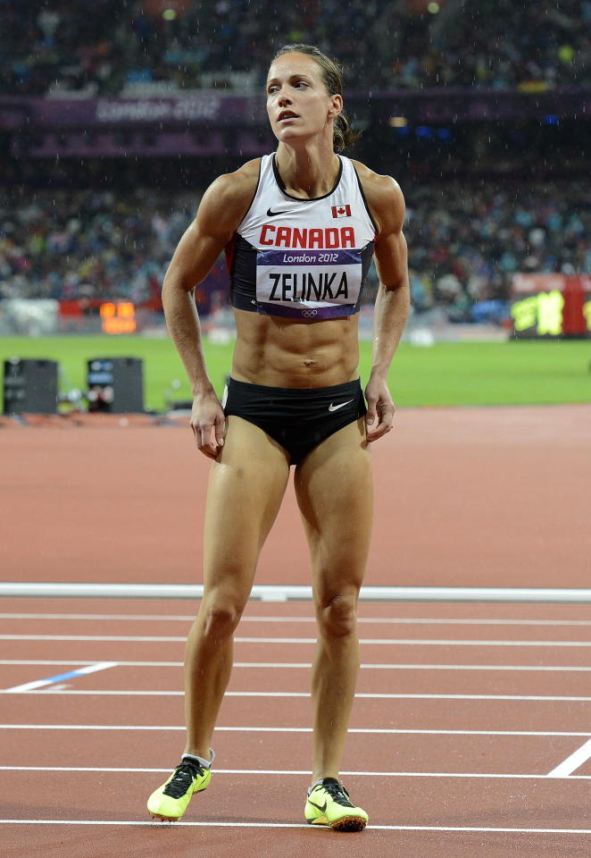 Canada's Jessica Zelinka reacts to her finish in the women's 100-metre hurdle final at the Olympic Stadium during the Summer Olympics in London on Tuesday, August 7, 2012. THE CANADIAN PRESS/Sean Kilpatrick