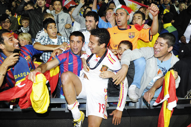 Spain's second goal scorer Thiago Alcantara, celebrates with supporters at the end of the UEFA Under-21 European Championship final match Spain vs Switzerland at the Aarhus Stadium, on June 25, 2011. .AFP PHOTO/JONATHAN NACKSTRAND (Photo credit should read JONATHAN NACKSTRAND/AFP/Getty Images)