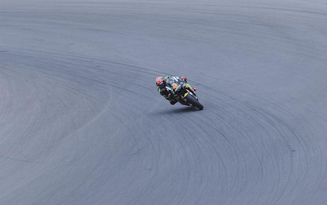 Moto GP rider Andrea Davizioso of Italy rides his Yamaha during the free practice session ahead of tomorrow's Czech Republic MotoGP category on August 25, 2012 in Brno. AFP PHOTO/ MICHAL CIZEKMICHAL CIZEK/AFP/GettyImages