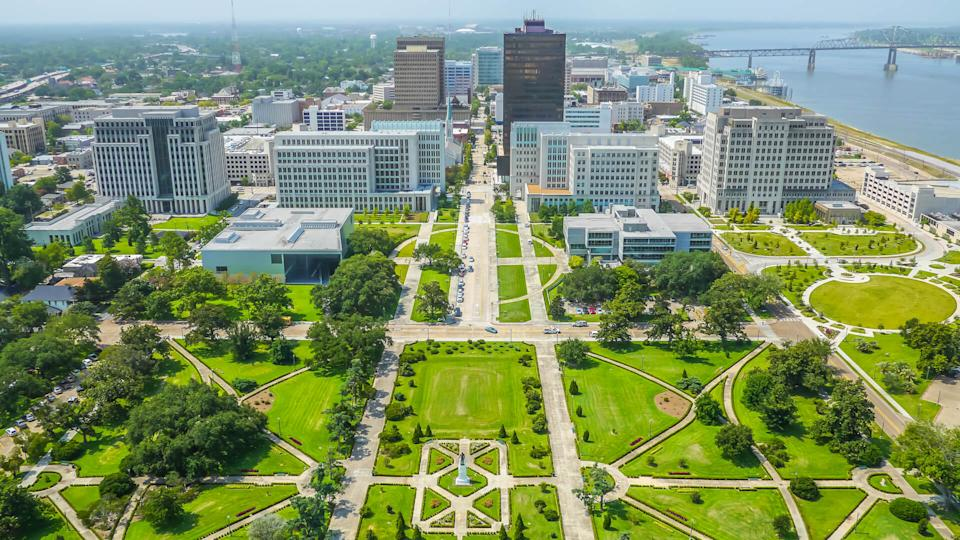 An aerial view of downtown Baton Rouge from the State Capitol building, looking towards the Mississippi bridge and river.