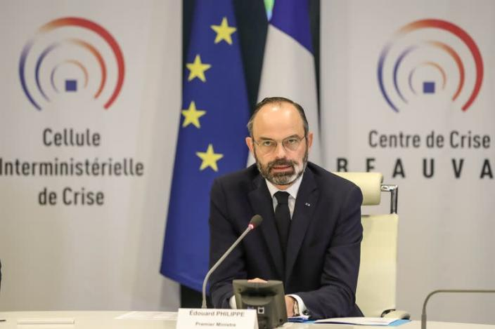 """French Prime Minister Edouard Philippe chairs a video meeting with French regions prefects on the coronavirus in the """"crisis room"""" of the French Interior ministry in Paris"""