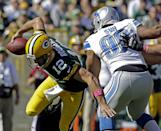 Green Bay Packers quarterback Aaron Rodgers tries to avoid Detroit Lions' Ndamukong Suh (90) during the first half of an NFL football game Sunday, Oct. 6, 2013, in Green Bay, Wis. (AP Photo/Jeffrey Phelps)