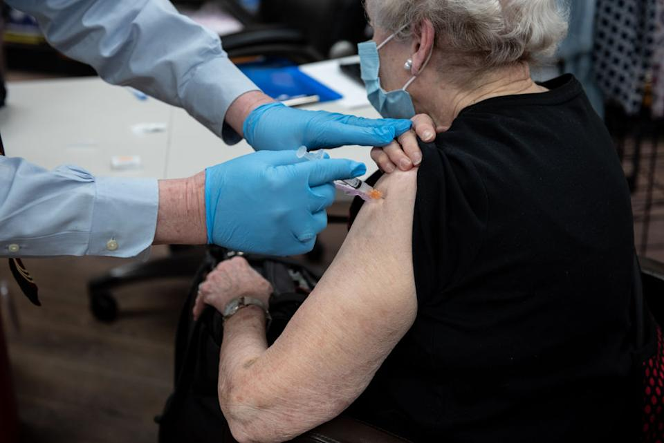 A pharmacist administers a dose of the Covid-19 vaccine in Mountain Brook, Alabama.
