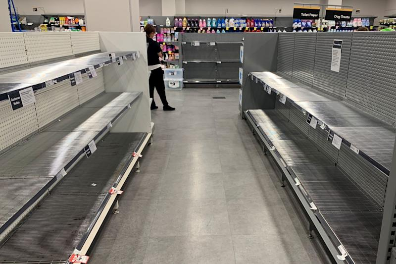 Supermarket shelves have been left bare as the virus spreads. Photo: AAP