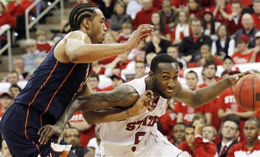 North Carolina State forward C.J. Leslie (5) drives to the basket past Virginia forward Mike Scott (23) during the second half of an NCAA college basketball game in Raleigh, N.C., Saturday, Jan. 28, 2012. Virginia won 61-60. (AP Photo/Jim R. Bounds)